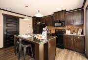 CMH Patriot 3/2 de doble ancho por $74,838 casa móvil cocinar #1